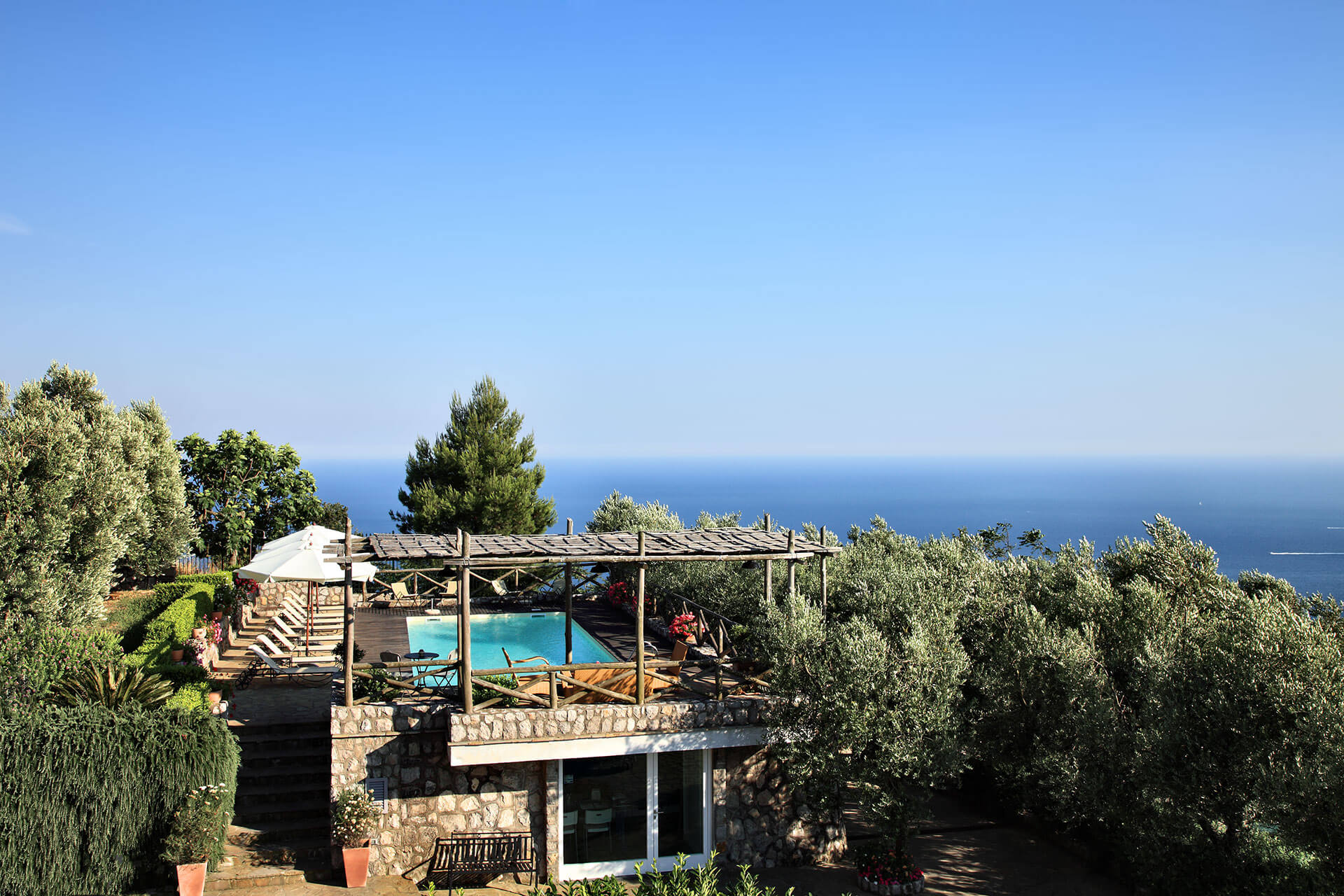 swimming pool with stunning sea view, holiday apartments